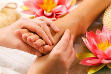Reflexology . Library Image: Foot with Flower